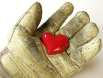 Heart in working glove Royalty Free Stock Photo