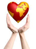 Heart world in hands Stock Photo