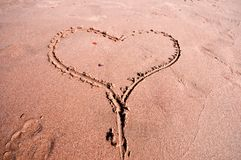 Heart written in the sand Royalty Free Stock Image