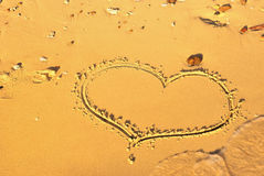 Heart written on the sand _3. One heart written on the sand on the beach of sea Stock Photography