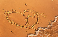 Heart written on the sand. On the beach of sea Royalty Free Stock Image