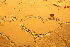 Heart written on the sand. On the beach of sea Royalty Free Stock Images