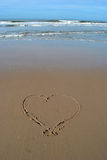 Heart written in sand at the beach Royalty Free Stock Image