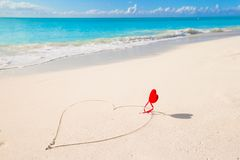 Heart written in white sandy tropical beach Royalty Free Stock Photos