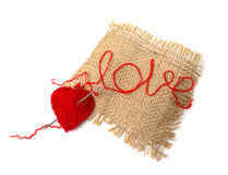Heart of yarn in cloth Royalty Free Stock Photo