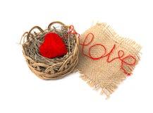 Heart of yarn in a wicker basket Stock Photos