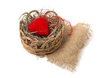 Heart of yarn in a wicker basket Royalty Free Stock Photos
