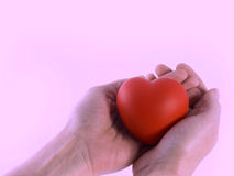 Heart for you. Isolated sponge heart and hand with room for copy ,text Royalty Free Stock Image