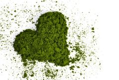 Heart from young barley or wheat grass isolated on white background. Royalty Free Stock Photo
