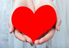 Heart in your hands Stock Photo