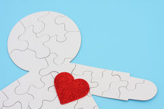 Heartbeat. Heart cut out on puzzle of body Stock Image