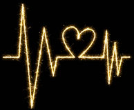 Heartbeat made by sparkler. Isolated on a black background Royalty Free Stock Image
