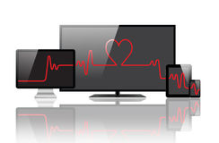 Heartbeat on the monitors Royalty Free Stock Photos
