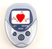 Heartbeat Pedometer. Heart and heartbeat on the face of a blue pedometer isolated on white Stock Photo