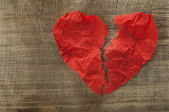 Heartbreak made ​​of curled red paper Stock Photography