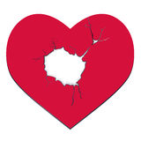 Heartbreak. The red heart with a hole. Royalty Free Stock Photography