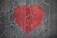 Heartbreak. Shape on crack wall Royalty Free Stock Photo