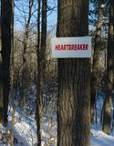 Heartbreaker sign on a hiking trail Royalty Free Stock Photography