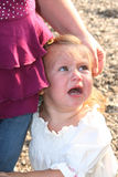Heartbroken Little Girl. Little girl crying at her mother's side royalty free stock images