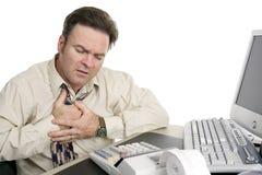 Heartburn auf dem Job Stockfotografie