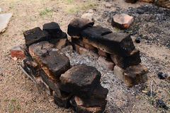 Hearth. The blackened hearth of bricks on sand royalty free stock photography