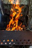 The hearth burn firewood and branches for coal.  royalty free stock image