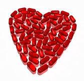 Hearth of capsules on white. Red transparent hearth of capsules on white Stock Image