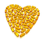 Hearth of capsules on white. Yellow transparent hearth of capsules on white Royalty Free Stock Photography