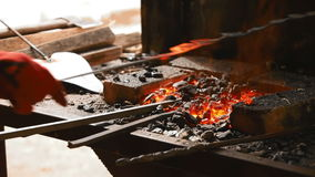 In the hearth are forged components for metallic flower stock video footage