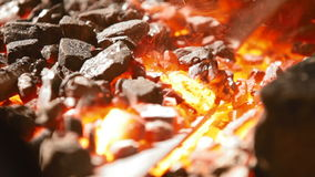 In the hearth are forged components for metallic flower stock footage