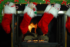 Christmas stockings with fireplace Stock Photos