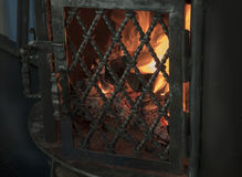 Hearth and home, an iron fireplace. Hearth and home, where the fire burns Royalty Free Stock Photography