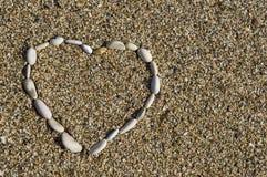 Hearth shape of beach rocks Royalty Free Stock Image