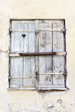 Hearth shape in a wooden window hatch Stock Photos