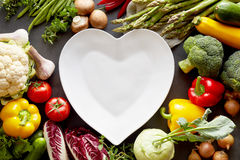Hearth shaped dish among vegetables Royalty Free Stock Images