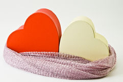 Hearths. Two hearths bound together by a scarf symbolizing attachment between people Royalty Free Stock Image