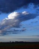 The Heartland. Clouds move over a farm on the Kansas prairie Royalty Free Stock Photos