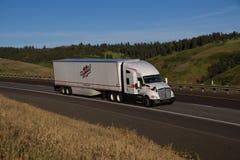 Heartland Express / White Kenworth Semi-Truck.  Stock Photos