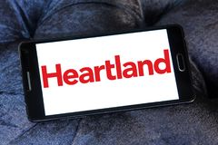 Heartland payment systems logo. Logo of Heartland payment company on samsung mobile. Heartland offers credit and debit card payment processing for small to large Royalty Free Stock Photography