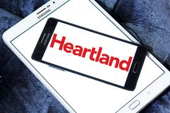 Heartland payment systems logo. Logo of Heartland payment company on samsung mobile. Heartland offers credit and debit card payment processing for small to large Stock Images