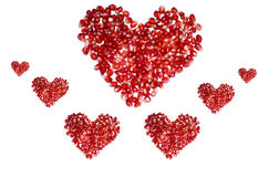 Hearts. Seven red pomegranate hearts  for background Stock Photos