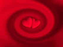 Hearts. Two little hearts into a red twirl Royalty Free Stock Photos