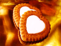 Hearts. Heart like biscuits over golden metallic surface Royalty Free Stock Photography