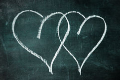 Hearts. Two hearts drawn with a chalk on a blackboard Stock Images