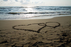Hearts. Written on the beach to show Stock Photography