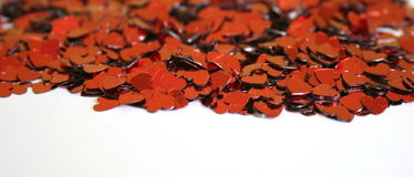Hearts. Many of red sequin hearts royalty free stock images