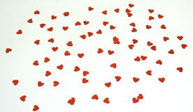 Hearts. Many of red sequin hearts royalty free stock photography
