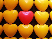 Hearts. Pink candy heart surrounded by yellow hearts Stock Images
