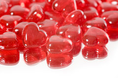 Hearts. A pile of miniature red glass hearts royalty free stock images