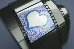 Hearts. A film reel with hearts background on it Stock Photography